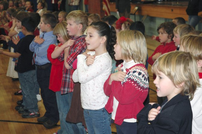 "South Routt Elementary School first-graders sing ""Proud of Our Veterans"" during an assembly Tuesday at the Yampa school."