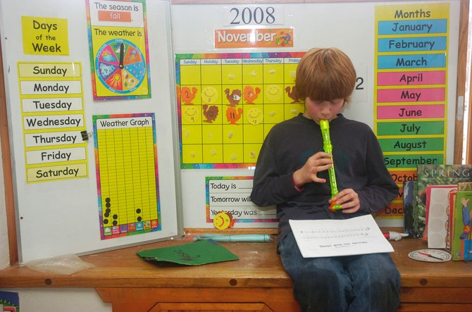 North Routt Community Charter School fifth-grader Ethan Cosgrove plays the recorder Thursday during music class. Ethan is one of 58 students attending the school.