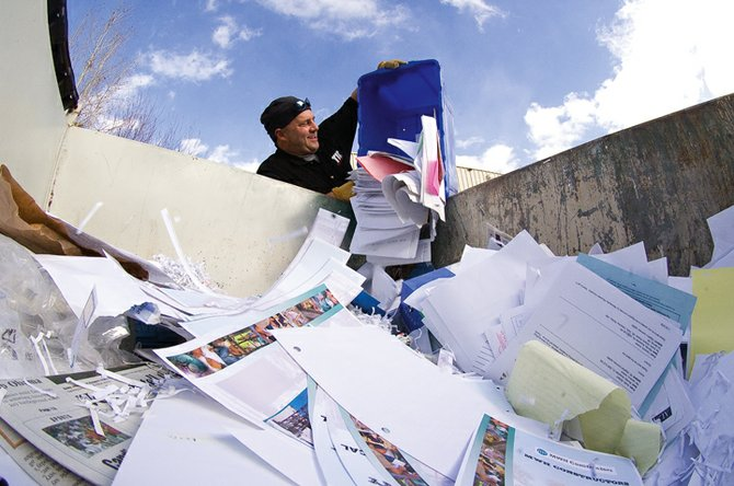 Sean Derning, the building maintenance technician for TIC, dumps paper into a Dumpster used for recycling behind the TIC corporate headquarters on Elk River Road. Yampa Valley Recycles recognized TIC, the Steamboat Ski and Resort Corp. and the Steamboat Springs School District Food Services Department as outstanding recyclers for their efforts in the past year.