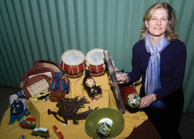 Event organizer Julie Alkema displays a small selection of items that will be available at this week&#39;s Work of Human Hands holiday fair trade bazaar, which will run Saturday and Sunday.  