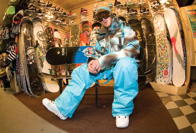 The Click employee Casey McGlone models some of the fashion trends for the 2008-09 snowboarding season, including a printed jacket and brightly colored pants.