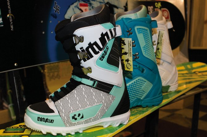 ThirtyTwo snowboard boots, priced between $199 and $249 at The Click, are popular because of their weight and warmth. The board on display beneath, from Lib Tech featuring the Skate Banana snowboard technology, isn't new this season but has become more available and popular and is expected to emerge everywhere on the slopes of Mount Werner. Priced at $469.95 at The Click, this design allows the tip and tail of the board better float in deep powder.