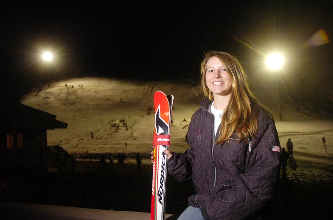 Anna Marno stands in front of Howelsen Hill with her skis. The 16-year-old is a member of the Steamboat Springs Winter Sports Club, and she is working toward joining the U.S. Ski Team in the next few years.