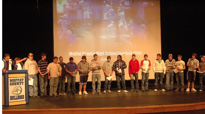 Moffat County football coach Kip Hafey, far left, introduces the 2008 letterman award winners during the annual team banquet and awards ceremony. The event, held Monday evening in the MCHS auditorium, showcased the highlights from the season.
