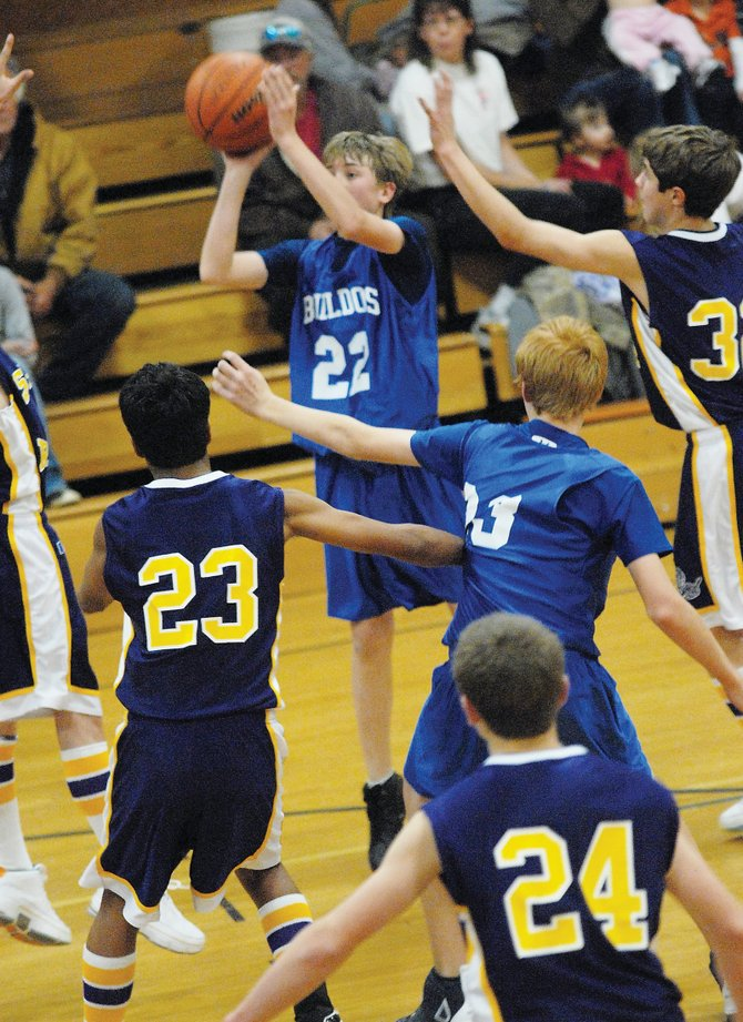 Craig Middle School eighth-grader Garrett Buckley sinks a bucket Tuesday against visiting Little Snake River Valley. The Bulldogs fell to the Rattlers, 52-18.
