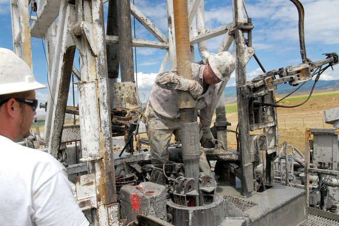 Field workers with Elenburg Exploration work on drilling a natural gas well for Beartooth Oil & Gas Co. in August. The well, located north of Craig, proved successful and was tied into existing pipelines in the county.