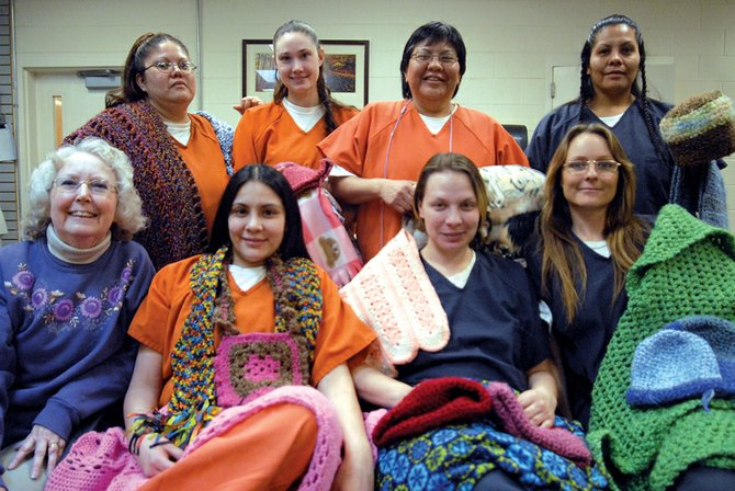 Peggy Bomba, of First Baptist Church, poses for a photo with crochet class pupils, front row from left, Shari McCloud, Katrina McCormick and Dawn Gordon; back row from left, Courtney Chegup, Megan Crook, Rose Sireech and Yolanda Rivera.