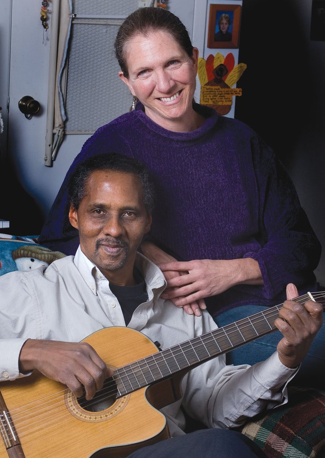Jazz Singer Pam Pierce and guitarist Neil Marchman pause for a photo while rehearsing in Pierce&#39;s living room for their concert Thursday night at the United Methodist Church.