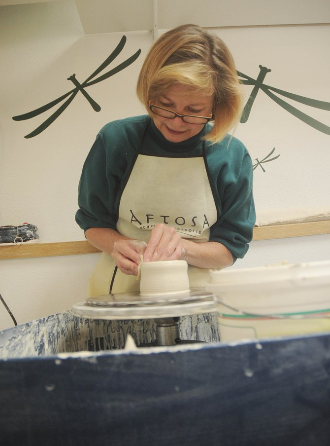 Steamboat Clay Artisan Deb Babcock throws a pot Wednesday at Blue Sky Pottery.