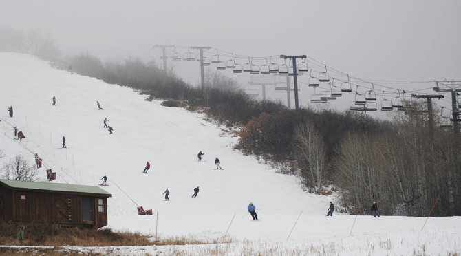Skiers and snowboarders ride down the See Ya trail at Steamboat Ski Area on Thanksgiving Day. Local resorts are expecting to see 4,000 visitors spending Saturday night in Steamboat Springs hotels and lodges.