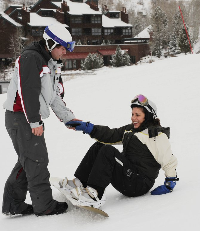 Steamboat Ski and Resort Corp. snowboard instructor Chris Rogers assists Denver resident Jennifer Kosatka on Saturday during her first day of snowboarding. A new service offered by partnering organizations allows skiers and snowboarders of all abilities to enjoy Steamboat Ski Area.