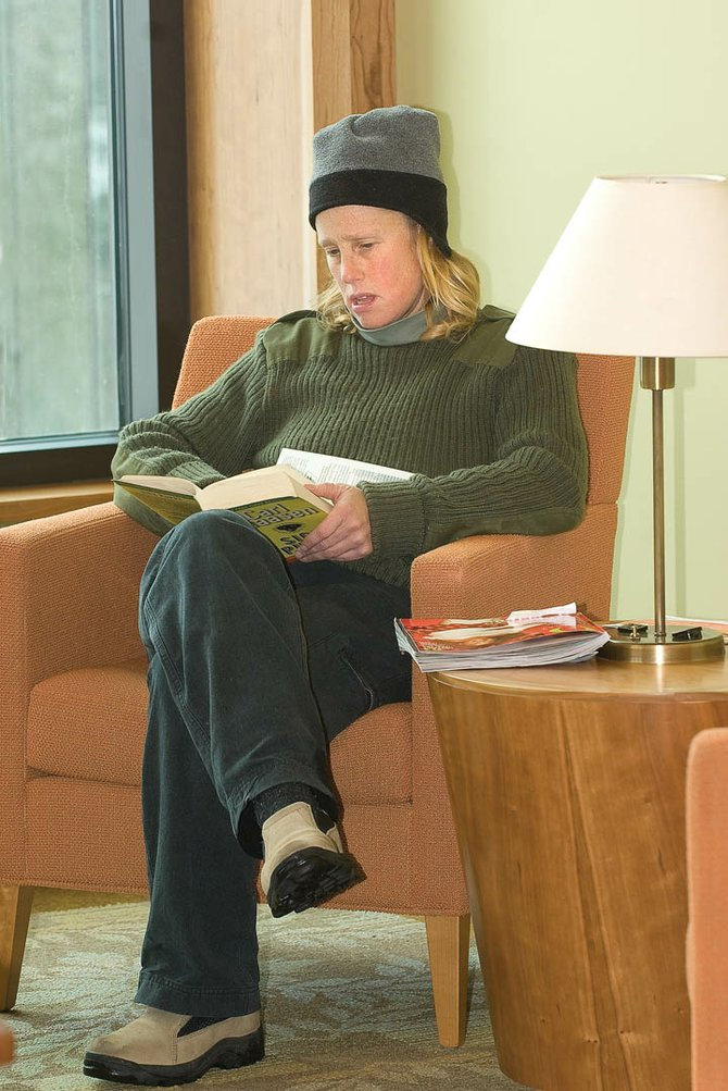 Carrie Westcott enjoys a good book at Bud Werner Memorial Library on Monday afternoon.