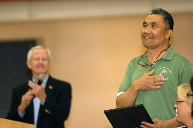 Steamboat Springs' Pio Utu reacts by putting his hand over his heart Tuesday night after being presented with the 9Who Care Award in front of a large crowd at Steamboat Springs High School.