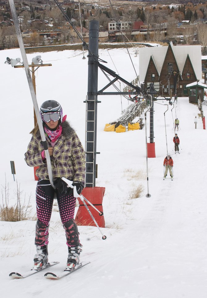 Lexie Baden rides the Poma lift at Howelsen Hill on Wednesday afternoon while training with the Steamboat Springs Winter Sports Club. The downtown Steamboat Springs ski area is scheduled to open to the public Saturday.
