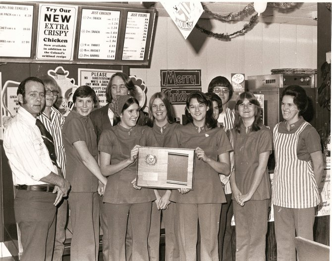 Saed Tayyara stands with his employees at Kentucky Fried Chicken in Craig. The photo was taken in the 1980s by Keith Gillam.