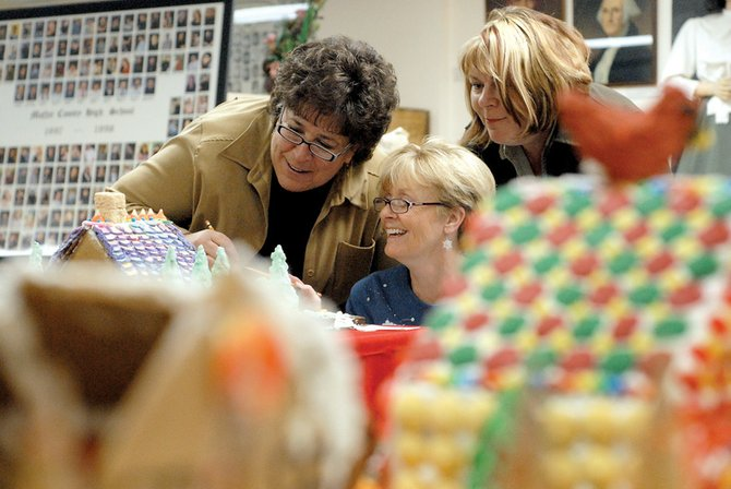 From left, Joanne Roberson, Martha Laliberte, and Renee Engel, judges for the 2008 Gingerbread House Contest, look over entries at the Museum of Northwest Colorado on Friday night. This year, there were 17 entries in the contest from local youths and adults.