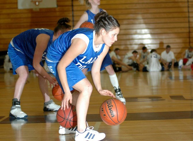 Moffat County High School senior Ariel Sanchez works on her dribbling skills during practice last season. The Bulldogs lost their first game of a four-day tournament Tuesday in Aurora, 78-30, to host Grandview High School.