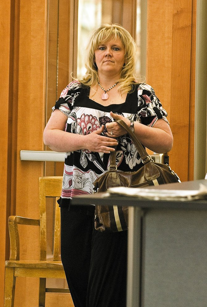 Routt County resident Pamela Williams, shown here entering the Routt County Justice Center for a May court appearance, pleaded guilty Tuesday to felony charges of theft and forgery. She could be sentenced to as many as 10 years in prison.