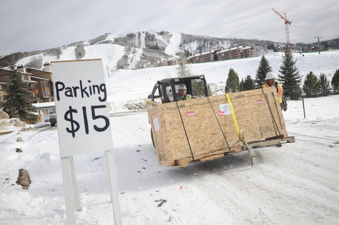 GE Johnson Construction Company employee Francisco Villalobos stables a crate Wednesday as it is taken out of the parking lot formerly used by Thunderhead Lodge at the base of the Steamboat Ski Area. Spots at the parking lot are being sold for $1,000 for the ski season. Proceeds will benefit the Steamboat Springs Winter Sports Club.