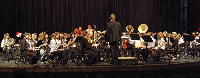 John Bolton directs the Moffat County High School Concert Band at the winter concert Tuesday night.