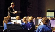 "The baton flies as director John Bolton leads the Eighth Grade Concert Band, from Craig Middle School, in ""The Parade of the Bumbling Wooden Soldiers"" on Tuesday night in the Moffat County High School auditorium. The Moffat County High School Concert Band, CMS Seventh Grade Concert Band and CMS Eighth Grade Jazz Ensemble also performed at the concert."