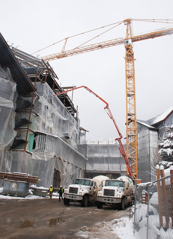 More than 300 construction workers bustle through the One Steamboat Place site daily. Construction is said to be on schedule for completion late in 2009.