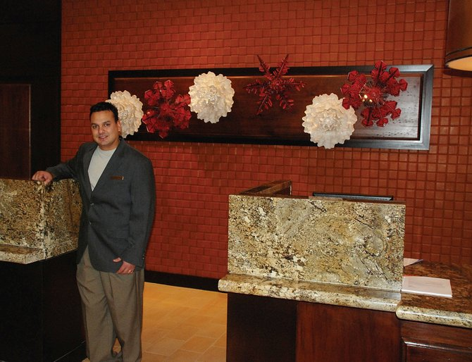 Longtime Steamboat Springs resident David Bradshaw is the front desk manager at the newly refurbished Sheraton Steamboat Resort. The wall behind Bradshaw is fashioned of woven leather.