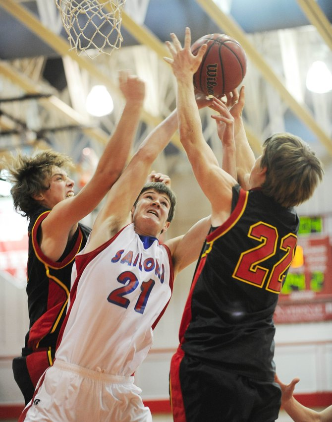 Steamboat Springs High School junior Austin Hinder tries to put up a shot Thursday night during Steamboat's game against Castle View High School at the Steamboat ShootOut basketball tournament.