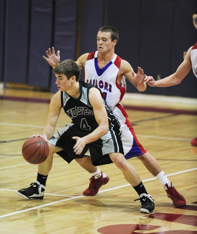 Steamboat Springs High School sophomore Charles Wood guards Green River's Colter Rood during Saturday's game.