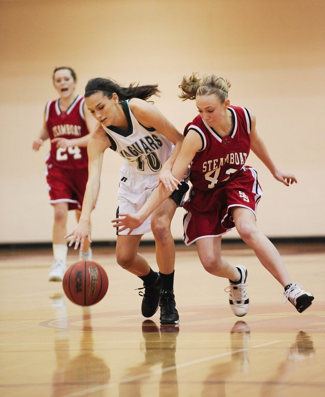 Steamboat Springs High School junior Matthia Duryea steals the ball from D'Evelyn High School's Krystal Pittman on Friday night during the Steamboat ShootOut basketball tournament. The Jaguars won, 74-37.