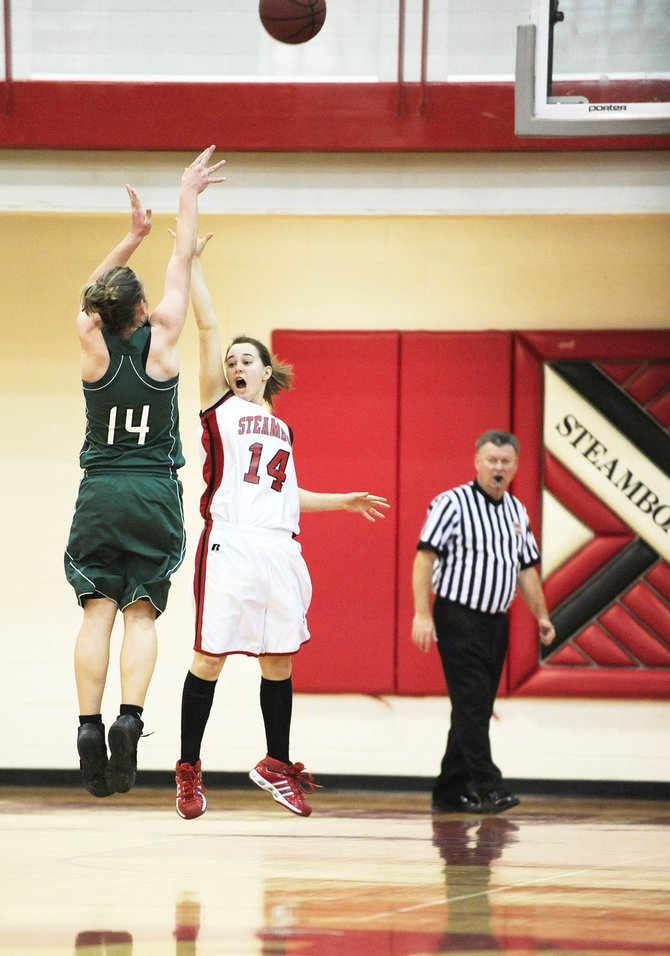 Steamboat Springs High School senior Amanda Willman tries to block a shot by Green River's Amanda Olguin during Saturday's game.