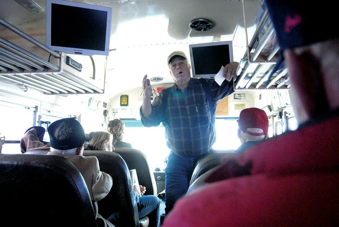 Lou Wyman talks about the history of the area Saturday on a bus traveling along U.S. Highway 40 between Hayden and Craig. Travelers were on the bus for the Parade of Museums, stopping at four museums from Steamboat to Craig.