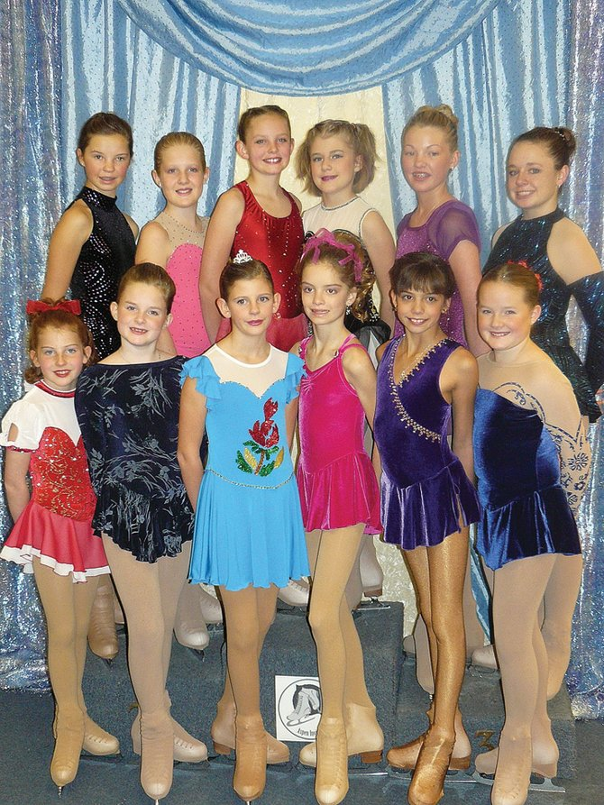 The members of the Steamboat Springs figure skating club that traveled to Aspen included, back row left to right, Kira Lorenzen, Callie Heil, Jenna Miller, Cassie Wilhelm, Ellie Bender and SaraPugh; the front row Left to right, included Nicole Zedeck, Kayla Haggarty, Clare Franklin, Emily Eakins, Patricia Davie and Hanna Haggarty.