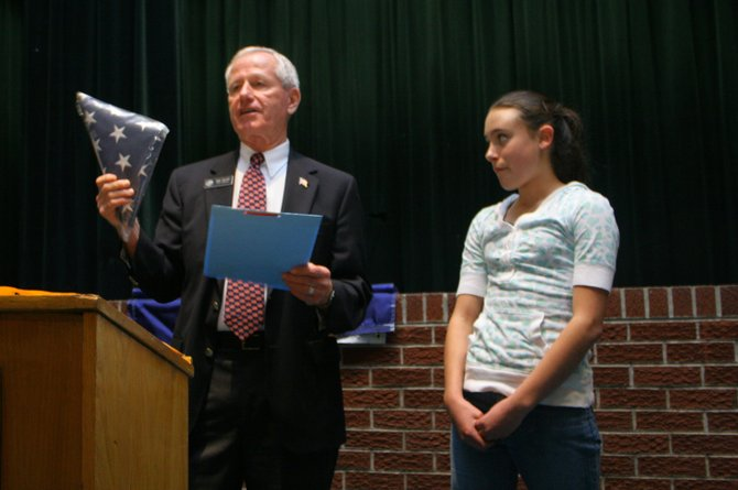 Outgoing state Sen. Jack Taylor honors Hayden Middle School student Heather Nereson on Wednesday with a framed certificate and a flag flown over the state Capitol in Denver. Taylor praised Heather's patriotism and work with the local American Legion.