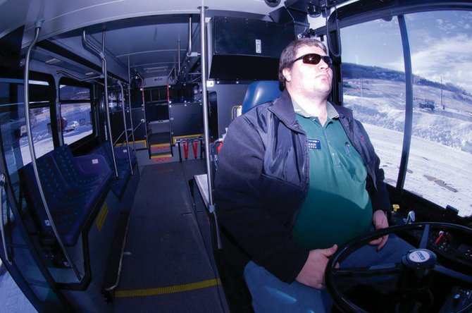 City bus driver Darrin Bevel takes a seat behind the wheel of the City of Steamboat Springs' new hybrid bus. The bus cost $500,000, but officials expect fuel savings to make up for the increased cost of the bus within five years.