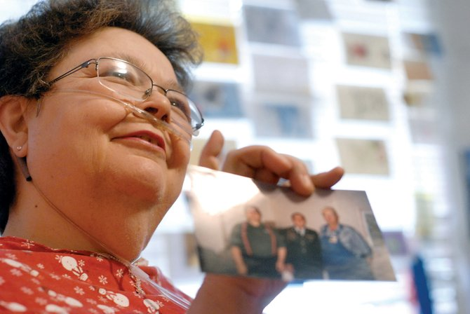 Craig resident Betty Rice holds up a picture of her husband, Ken, and two sons, Dan, 35, and Brian, 33. Rice, a resident at Sandrock Ridge Care & Rehab, was a foster mother to 38 foster children during a period of about 12 years.