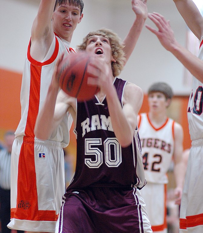 Soroco senior Robert Anderson is left with nowhere to go as Hayden junior Murphy Smartt towers over him beneath the basket Thursday night as the Tigers (4-2) handed the Rams (5-1) their first loss of the season. Smartt led all scorers in the game with 26 points. The Tigers won, 63-54.