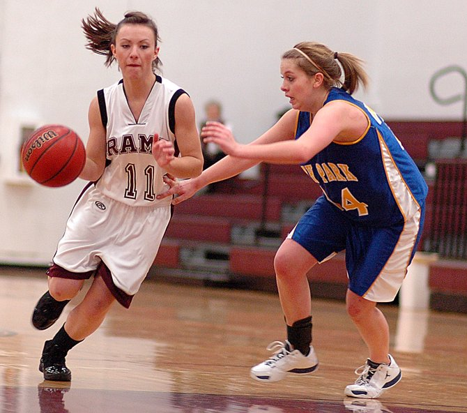 Traci Schlegel drives toward the basket Saturday as the Rams lost to the Wildcats, 53-46. It was Soroco's ninth consecutive loss in the series.