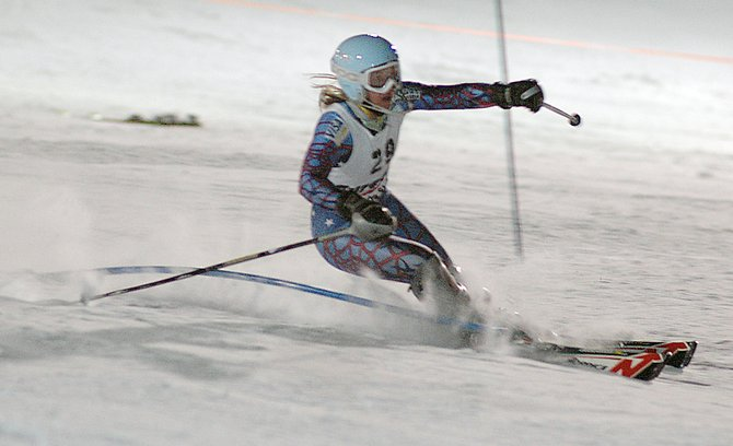 Anna Marno makes a cut through a gate Sunday during her second run at the Holiday Classic women's slalom race at Howelsen Hill. Marno was the top local finisher on the first day of the three-day slalom skiing event. Action resumes at Howelsen at 8:30 a.m. today when the women go again. The men will start their competition today at 4:45 p.m.