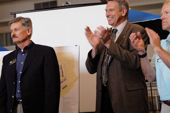 Rep. Al White, R-Hayden, left, announces Colorado Northwestern Community College will receive $23.5 million in state funds for the construction of a new academic building during a press conference in May at the Holiday Inn of Craig. John Boyd, CNCC president, middle, and Gene Bilodeau, Craig campus dean, applaud the measure. The state projects to see as much as $1 billion in budget shortfalls in 2008 and 2009. Boyd said the college hasn't received any notice of mid-year funding cuts.