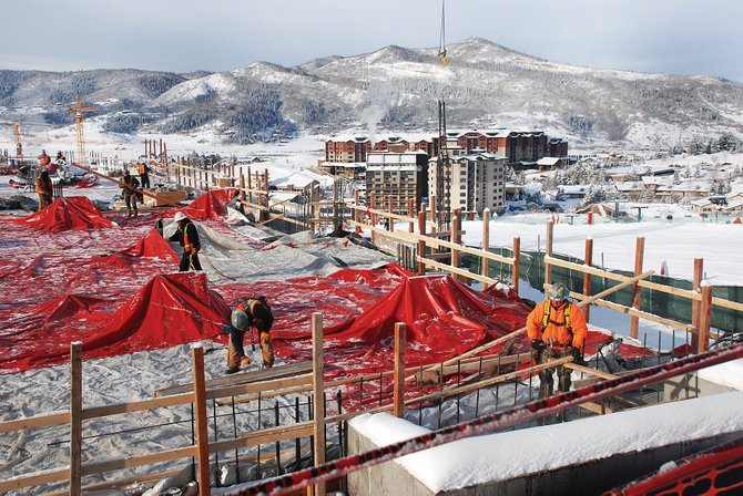 Construction workers for GE Johnson installed rebar at the new Edgemont condominium project during a frigid Christmas Eve morning Wednesday. The Sheraton Steamboat Resort and Steamboat Grand Resort Hotel are visible in the background.