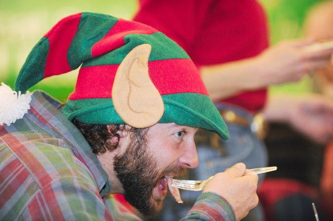 Steamboat Springs resident Cory Ecklund takes a bite of ham Thursday during the Community Christmas Dinner, sponsored by the Steamboat Springs Board of Realtors, at the Community Center.