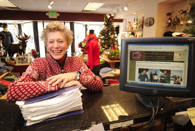Moose Mountain Trading Co. owner Jenny Wall shows the binder holding her online orders from December on Wednesday. Online sales are becoming a larger part of her business every year.