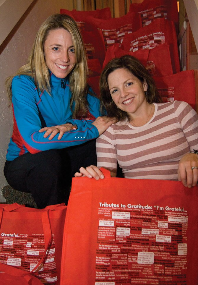 "Sisters Wendy Puckett, left, and Kristen Stevenson, owners of the Steamboat Pilates and Fitness Studio, combined efforts to create the ""Tributes to Gratitude"" bag. The proceeds from the sale of the reusable bags, which are plastered with quotes from local schoolchildren based on what they feel is important, will be given to the schools."