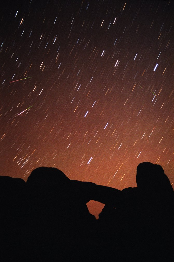 This image was taken on the night of Nov. 17, 2001, from Arches National Park during the Leonid meteor storm of that year. The stars of Leo the Lion made short trails across the film during the 7-minute time exposure while several bright meteors streaked across the sky, all pointing back to Leo. Another Leonid mini-storm is predicted for Nov. 17 over the western U.S.