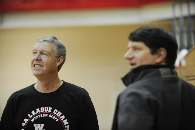 Former Steamboat Springs High School boys basketball coach Kelly Meek attends practice Tuesday and visits with former player Matt Aljanich, a 1984 graduate. On March 28, Meek will be inducted into the Colorado High School Coaches Association Hall of Fame.