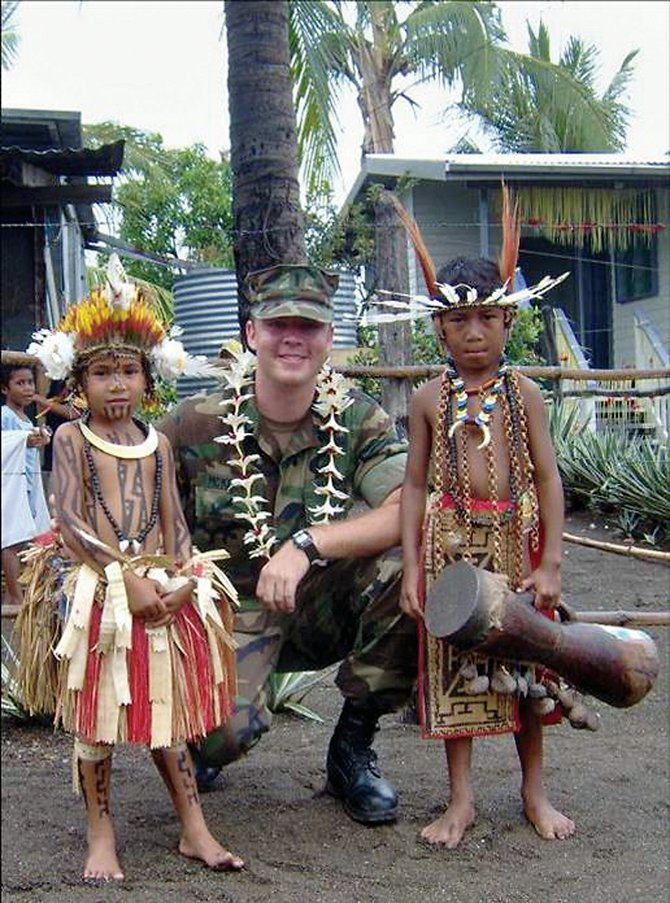 Navy officer Jamie McKelvie, of Steamboat Springs, poses with youngsters in Papua, New Guinea, in the midst of a Pacific Partnership Mission. McKelvie and his colleagues helped build two medical aid stations, among other projects.
