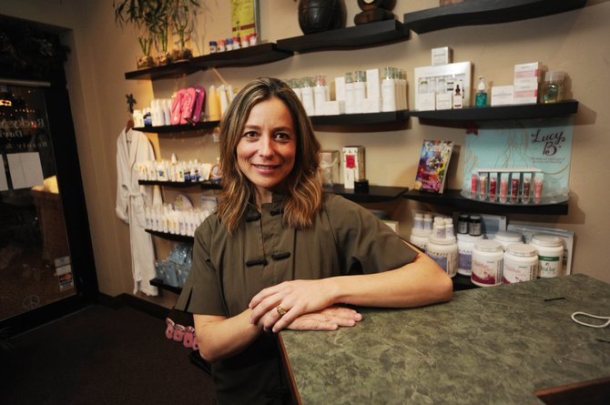 Seana Cardillo, who owns and operates Rocky Mountain Day Spa, says traffic from visitors and part-time residents has been steady despite the economy.