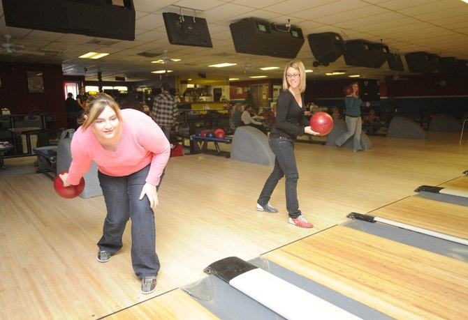 Partners in Routt County mentor Nicole Williams, right, takes her partner, Lluvia, 14, bowling Wednesday. Lluvia scored two strikes in the first four frames.