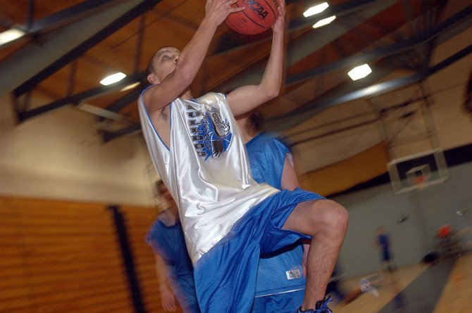 Oscar Ramos, shown at high school practice Monday, is one of several Bulldog varsity basketball players - boys and girls - who played AAU basketball. Coaches are still needed for the 2009 Amateur Athletic Union basketball season that begins in a few weeks.